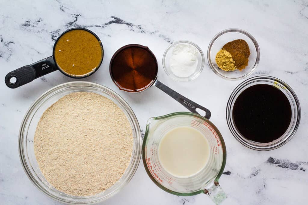 flour, milk, molasses, spices, baking powder, maple syrup, and almond butter ingredients
