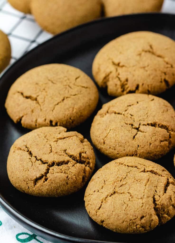 vegan ginger cookies on black plate
