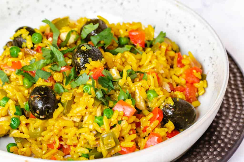 vegan paella topped with olives and cilantro