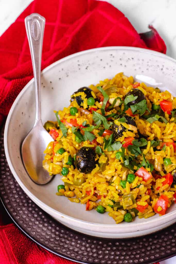 vegan paella with black olives and cliantro