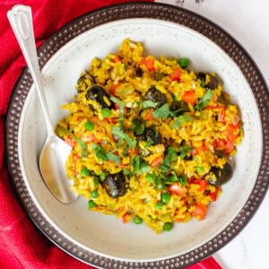 vegan paella in bowl with spoon
