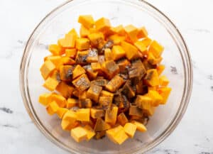 butternut squash and spices in bowl