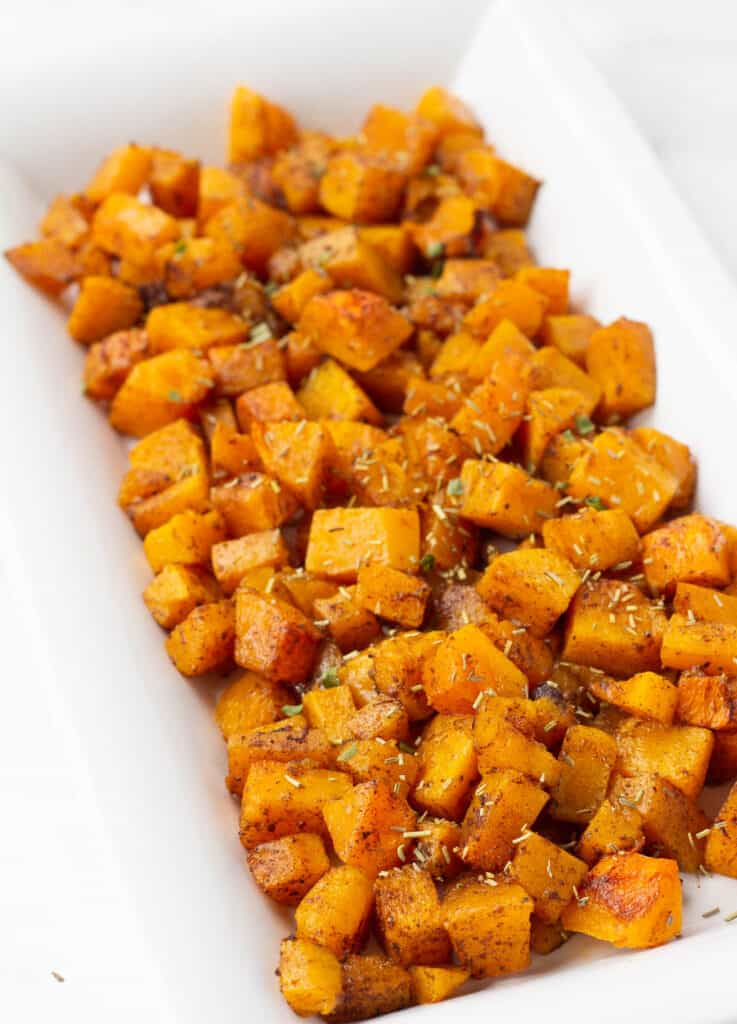 cinnamon butternut squash topped with herbs