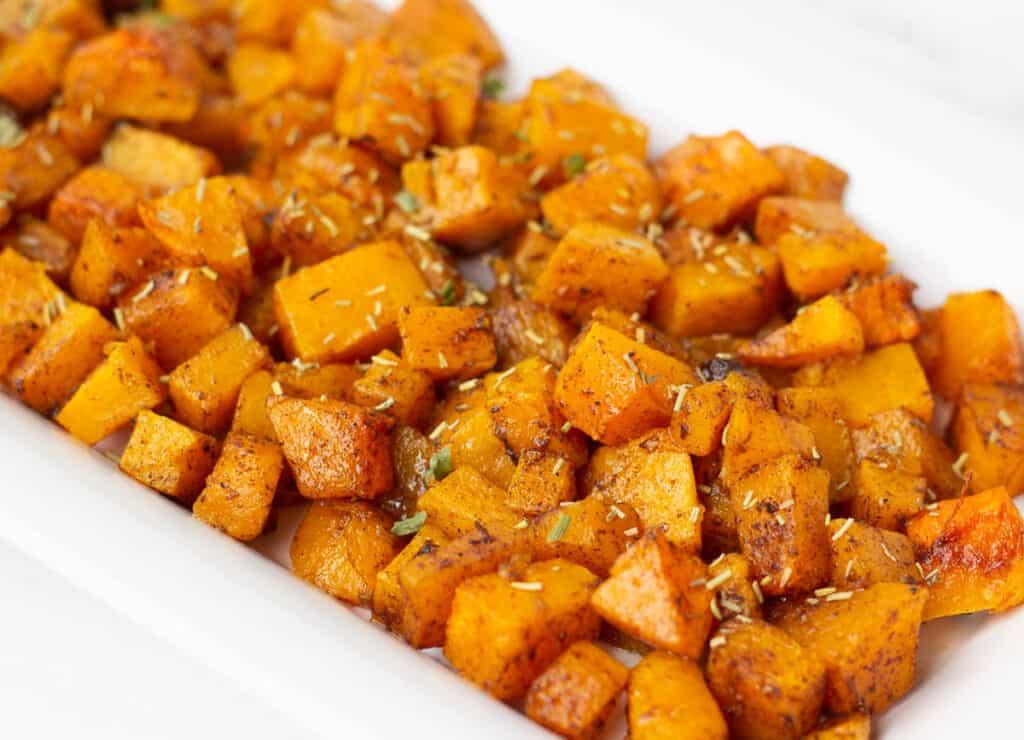 roasted cinnamon butternut squash on white serving platter