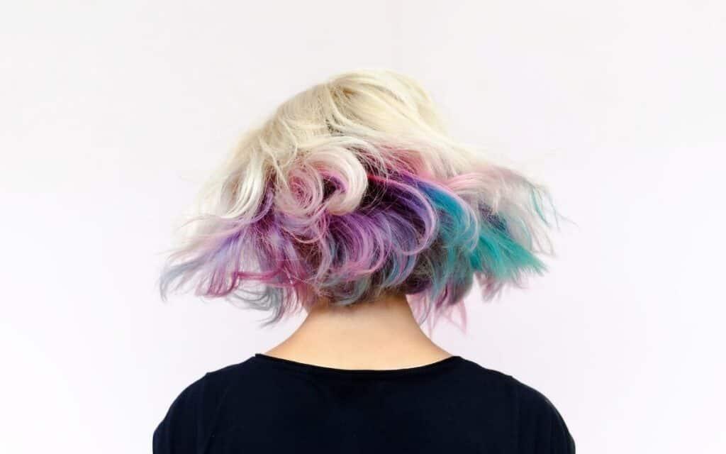 girl facing backward with colorful hair