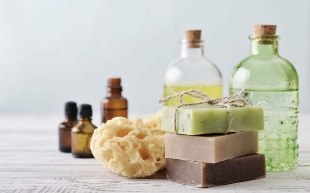 natural soaps, bottles, and sponge