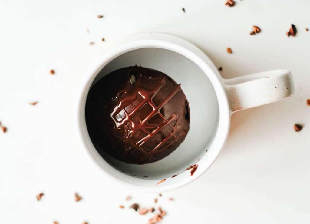 vegan hot chocolate bomb in white mug