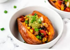 stuffed sweet potatoes in white bowl