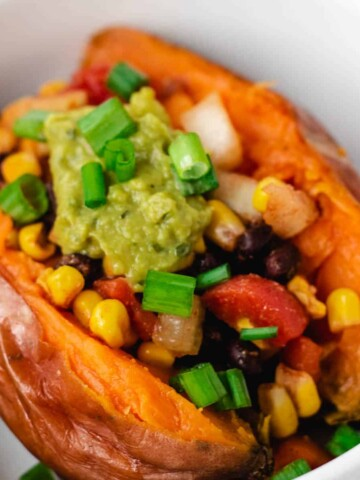 vegan loaded sweet potatoes with black beans and corn