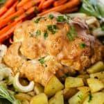 vegan roast dinner: cauliflower, potatoes, carrots, and onions