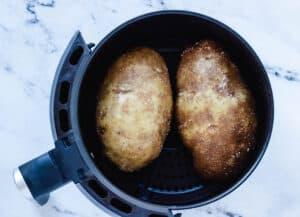 raw potatoes in air fryer basket