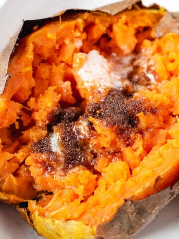 air fryer baked sweet potato with butter and brown sugar