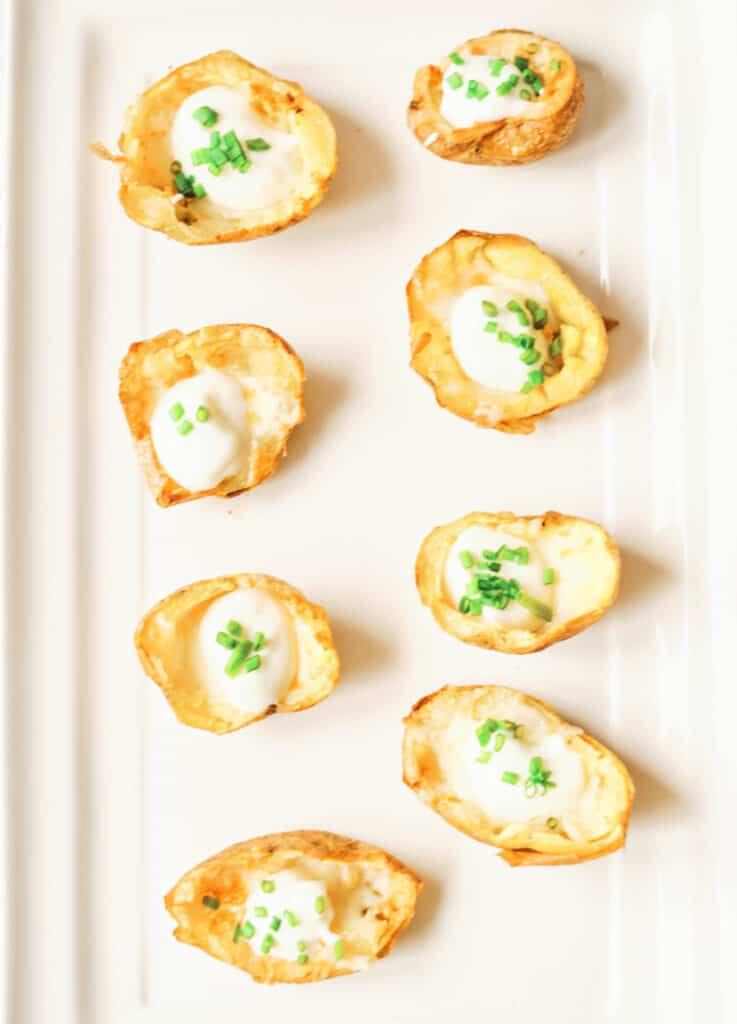 potato skins on white square serving plate