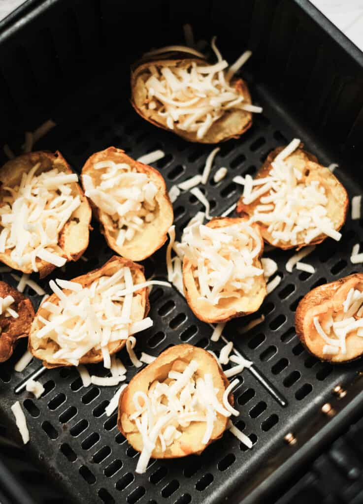 potato skins filled with cheese in air fryer basket