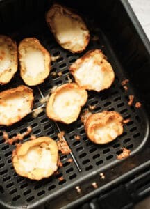 potato skins with melted cheese in air fryer basket