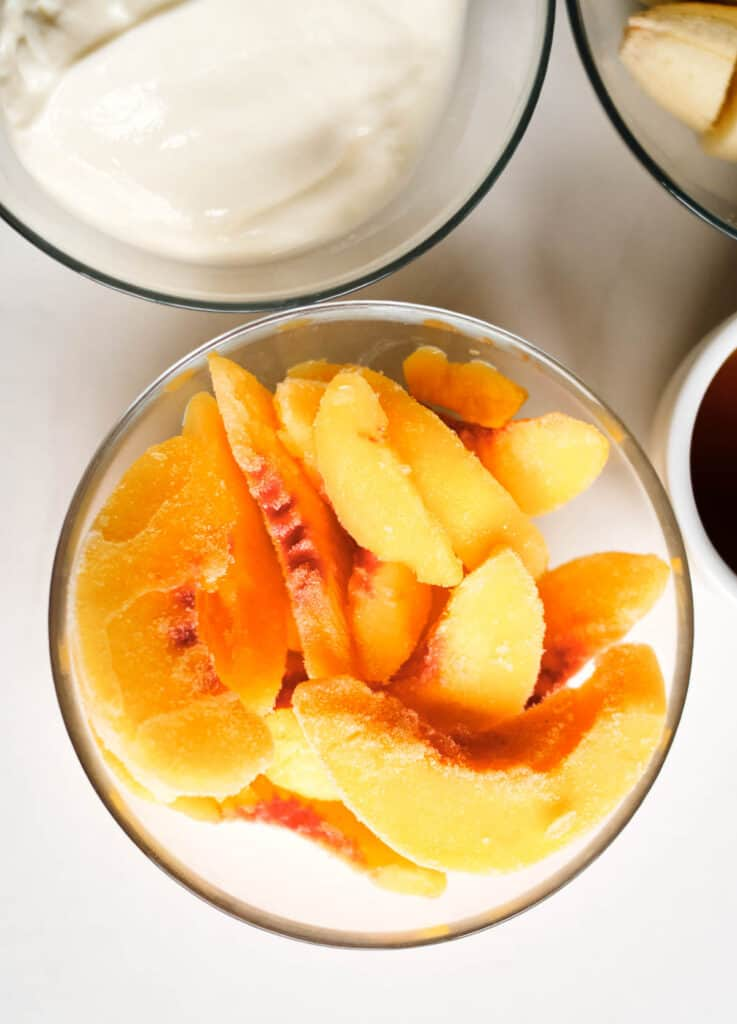 frozen peaches in glass bowl