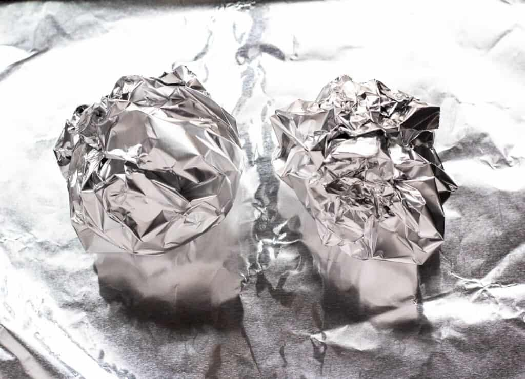 2 beetroot bulbs wrapped in aluminum foil