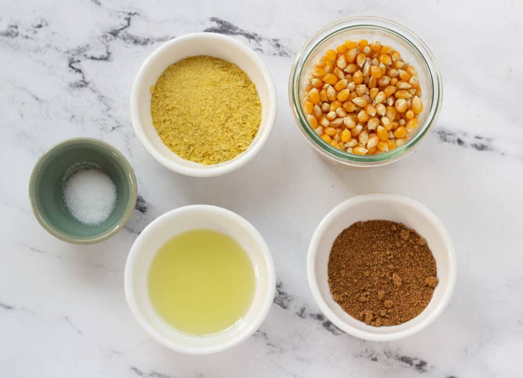 corn kernels, coconut sugar, nutritional yeast, avocado oil, and salt in small bowls