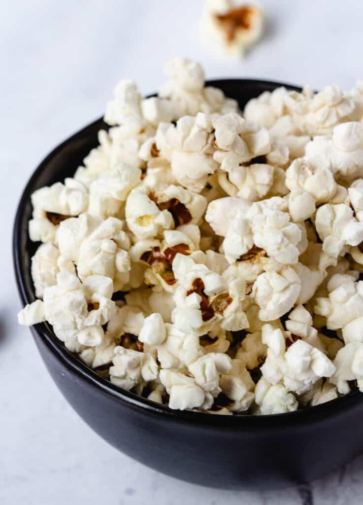 close up of popcorn in black bowl