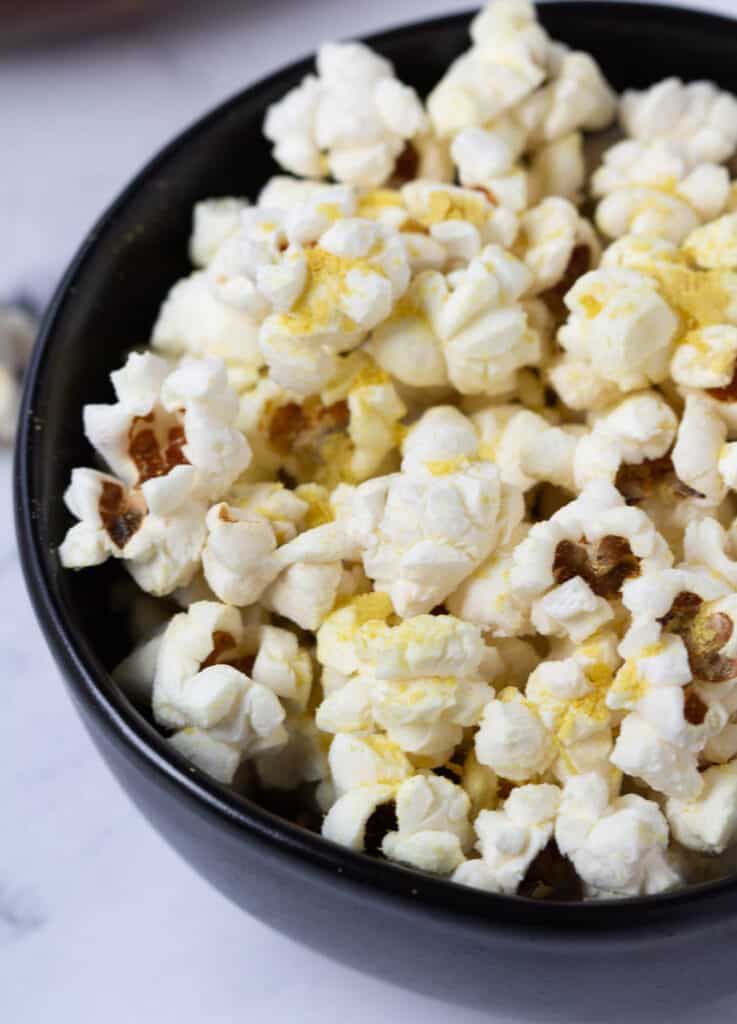 close up of popcorn covered in nutritional yeast