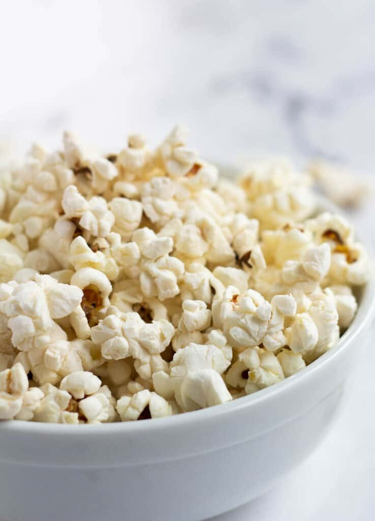 close up of popcorn in white bowl