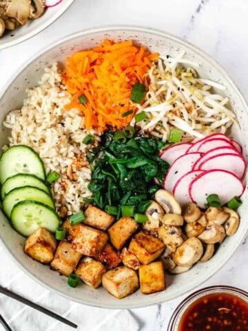 overhead vegan bibimbap with crispy tofu