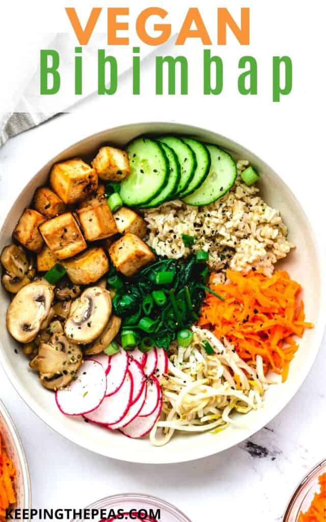 overhead of vegan bibimbap with mixed vegetables and baked tofu