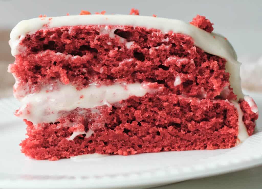close up of red velvet cake on white plate