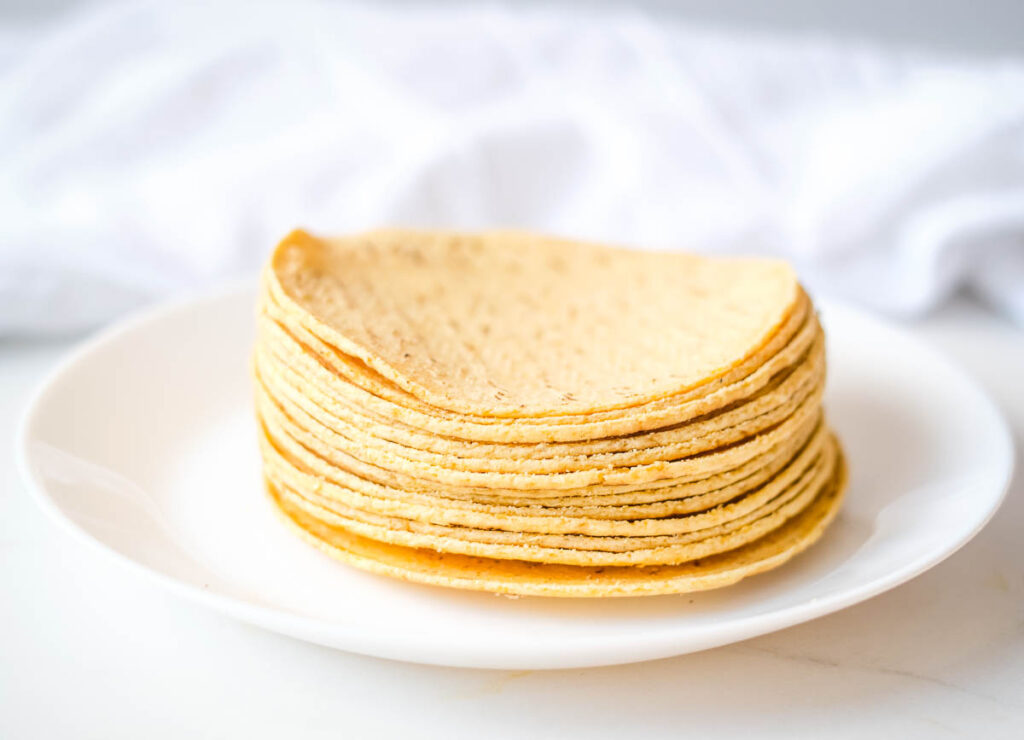 stack of corn tortillas on white plate