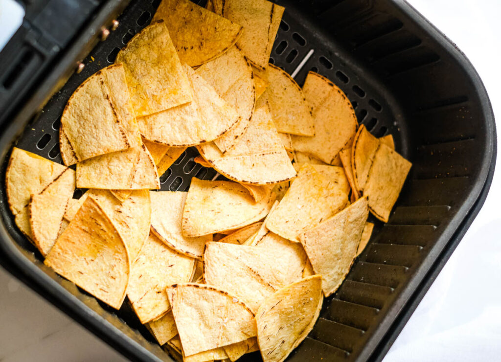 crispy tortilla chips in air fryer basket