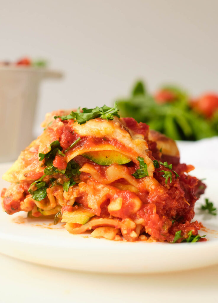 slice of gluten-free vegan lasagna on white plate