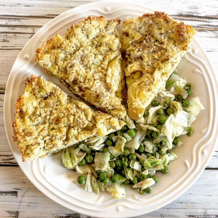 slices of vegan potato pie with peas on white plate