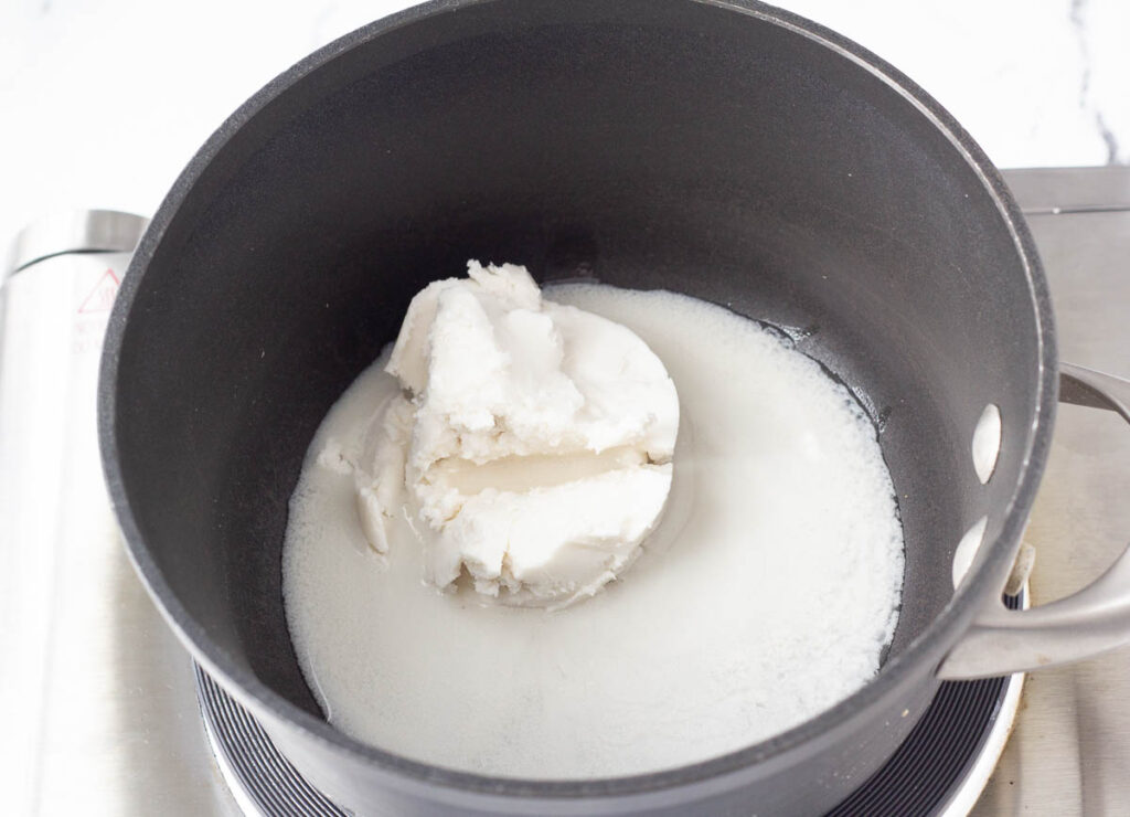 coconut cream melting in saucepan