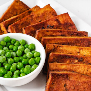 vegan corned beef and peas on serving dish