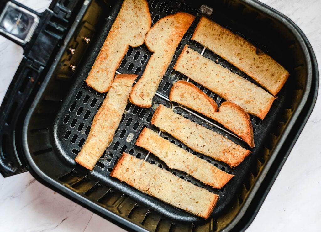 strips of bread baked until golden brown in an air fryer basket