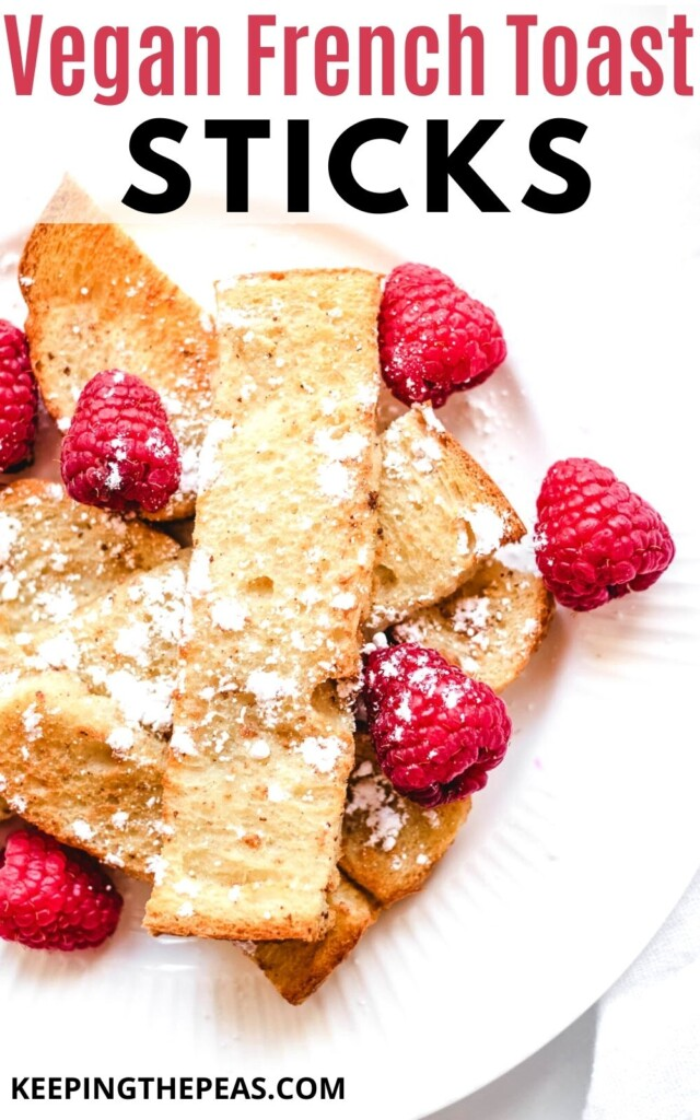 vegan french toast sticks on white plate topped with raspberries