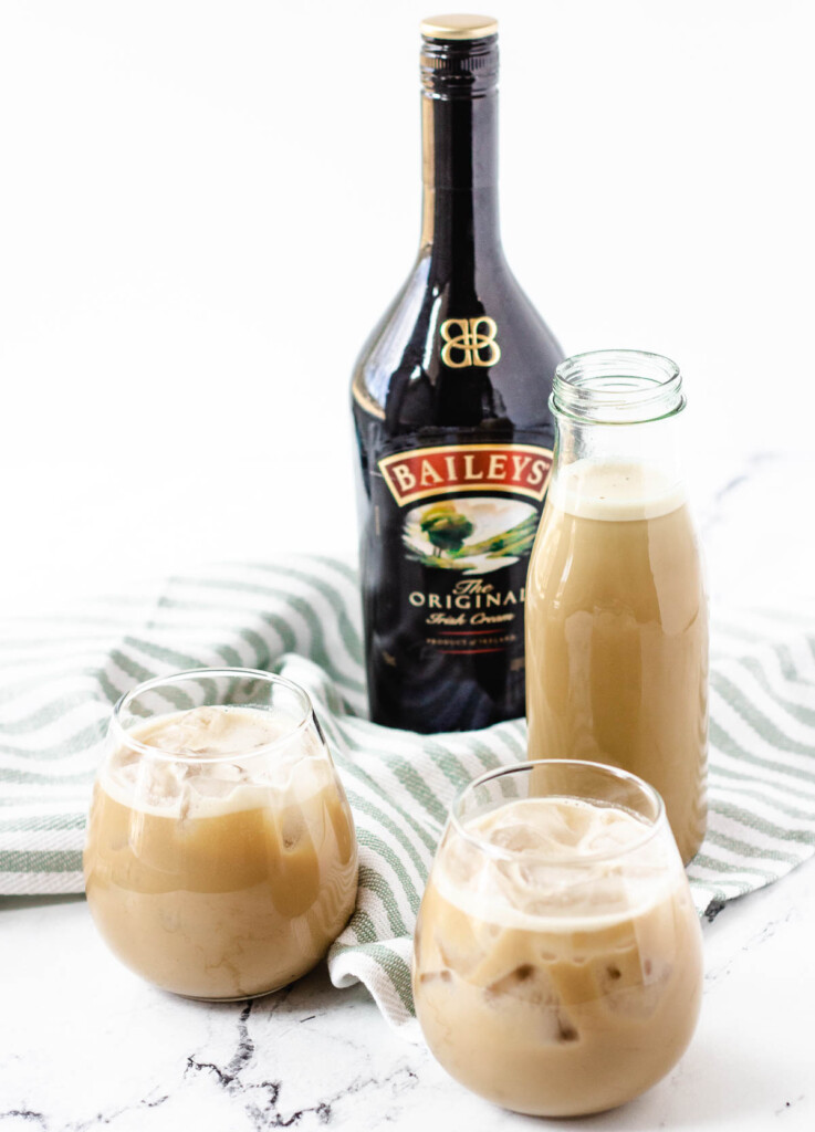 vegan Bailey's Irish cream in stemless wine glasses with Bailey's bottle in the background