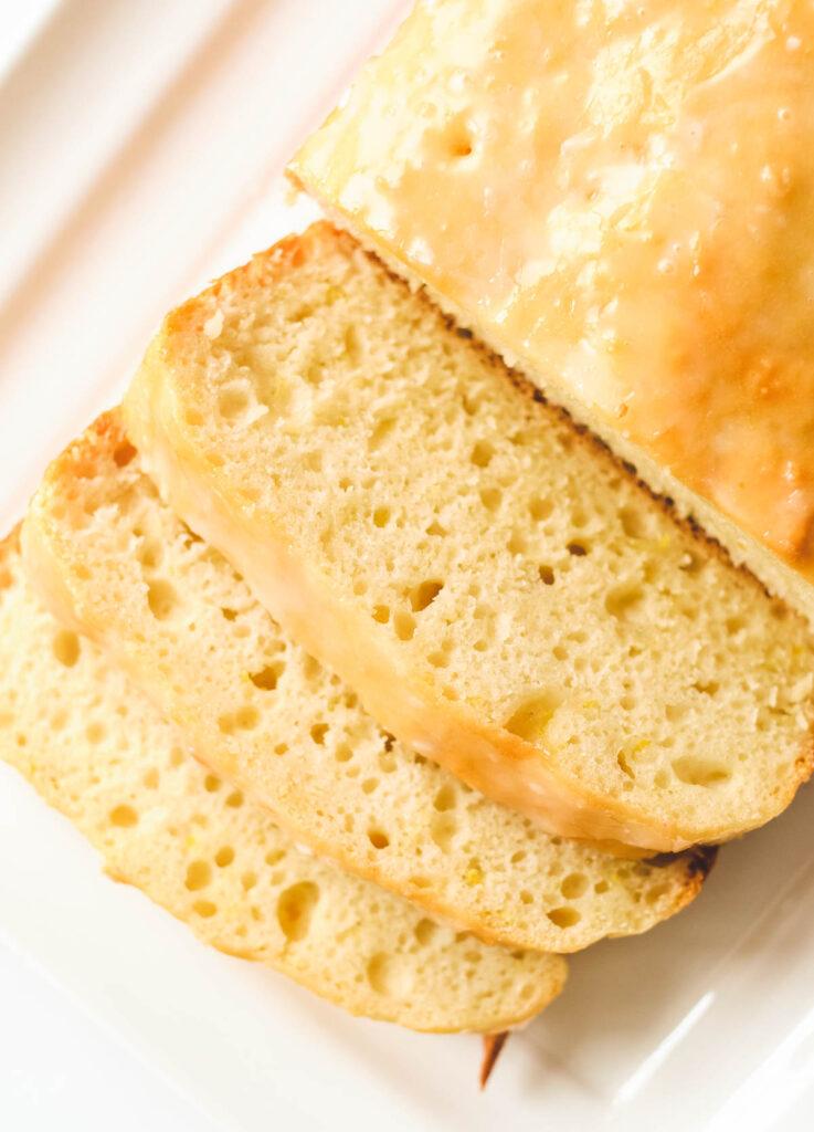 vegan lemon loaf covered with glaze