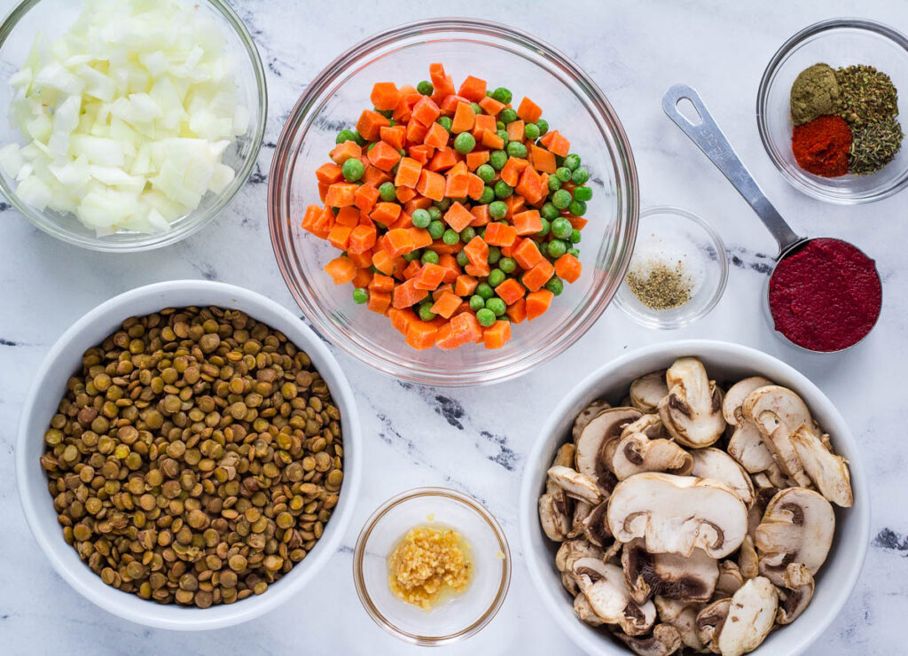 Lentil Shepherd's pie filling: lentils, peas and carrots, mushrooms, onions, garlic, tomato paste, salt and pepper, and dried herbs