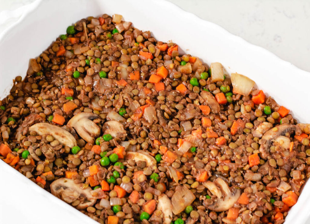lentils, mushrooms, peas and carrots in baking dish