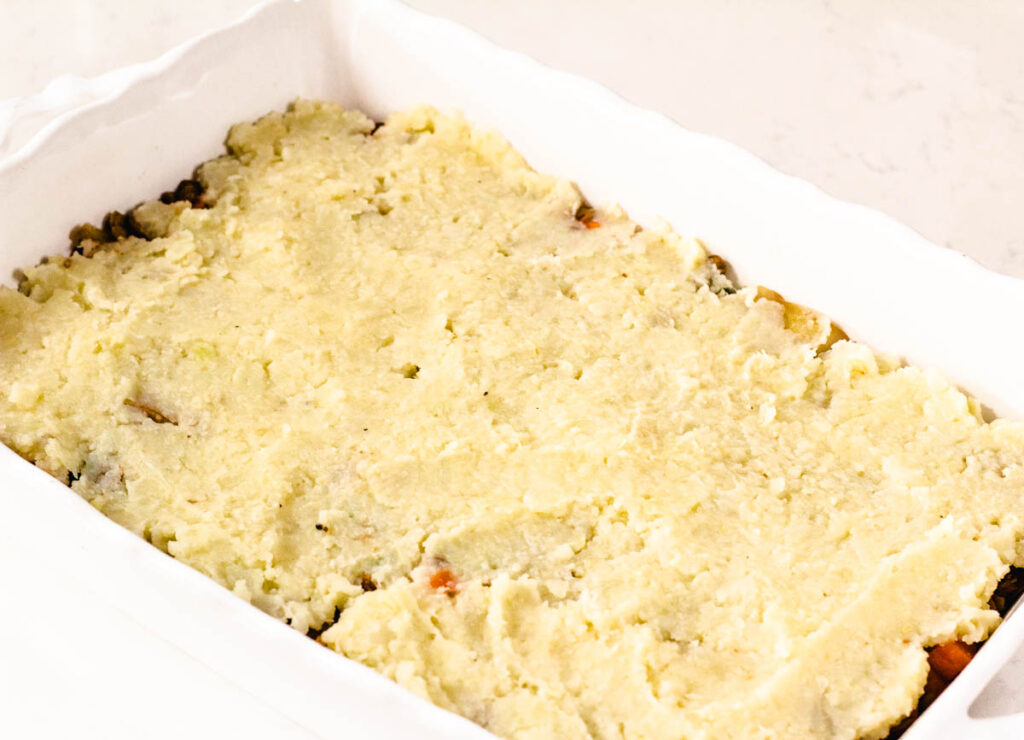 pre cooked lentil shepherd's pie in baking dish topped with mashed potatoes