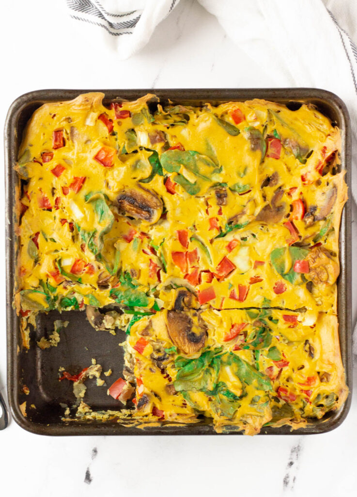 vegan breakfast egg casserole with mushrooms, peppers, and spinach