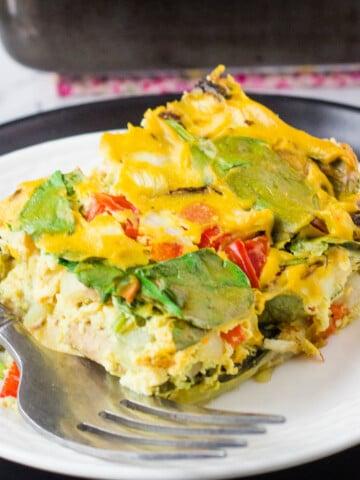 vegan breakfast casserole slice on white plate with fork