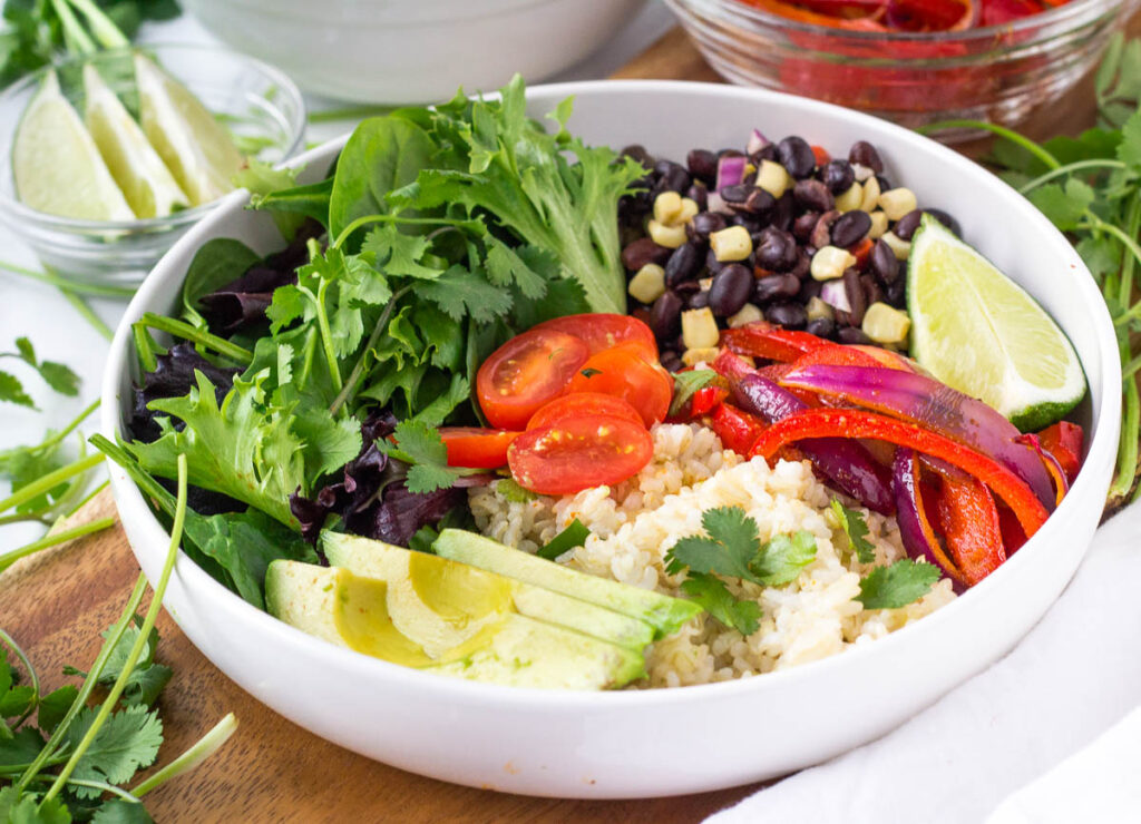 copycat chipotle burrito bowl with veggies and beans