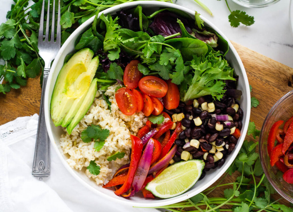 copycat chipotle bowl with brown rice, vegges, and black beans