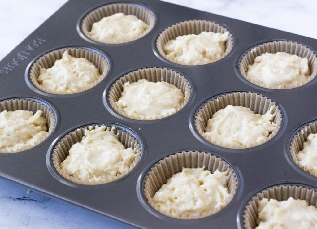 lemon cupcake batter in cupcake tin