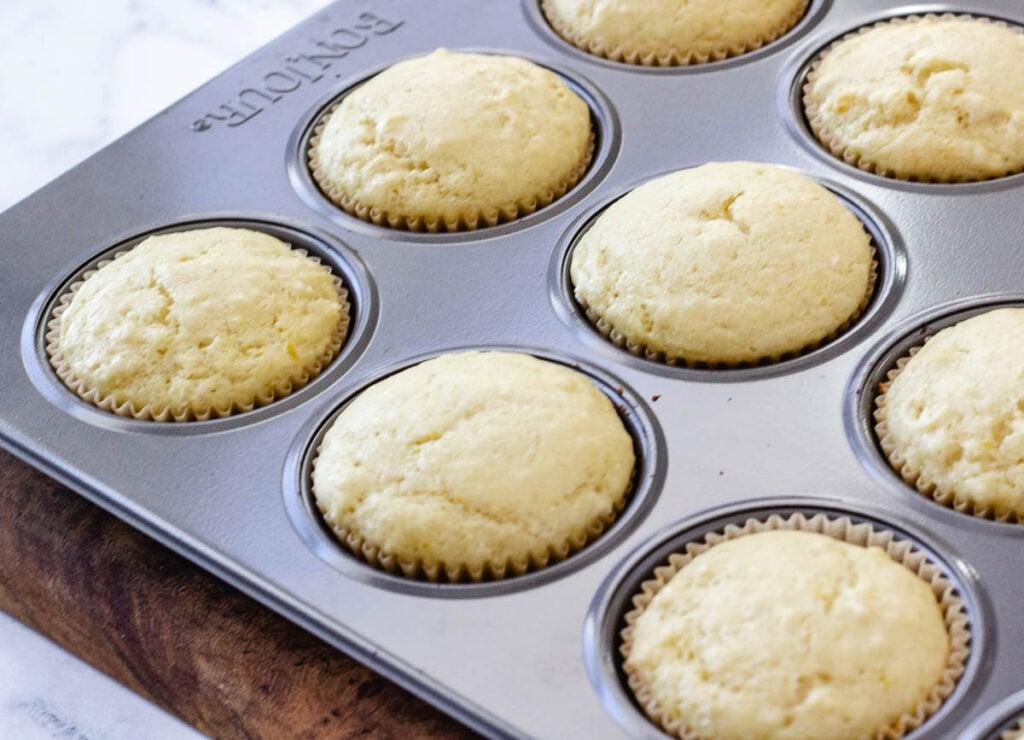 baked lemon cupcakes in cupcake tin