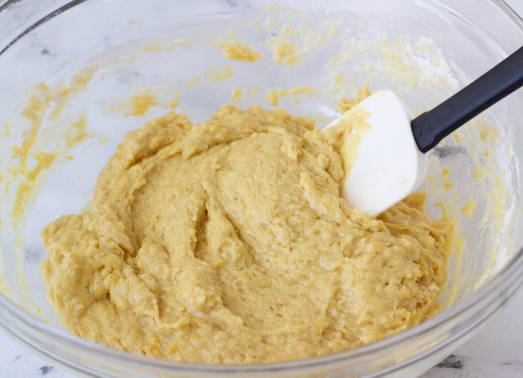 yellow cake batter in mixing bowl with spatula