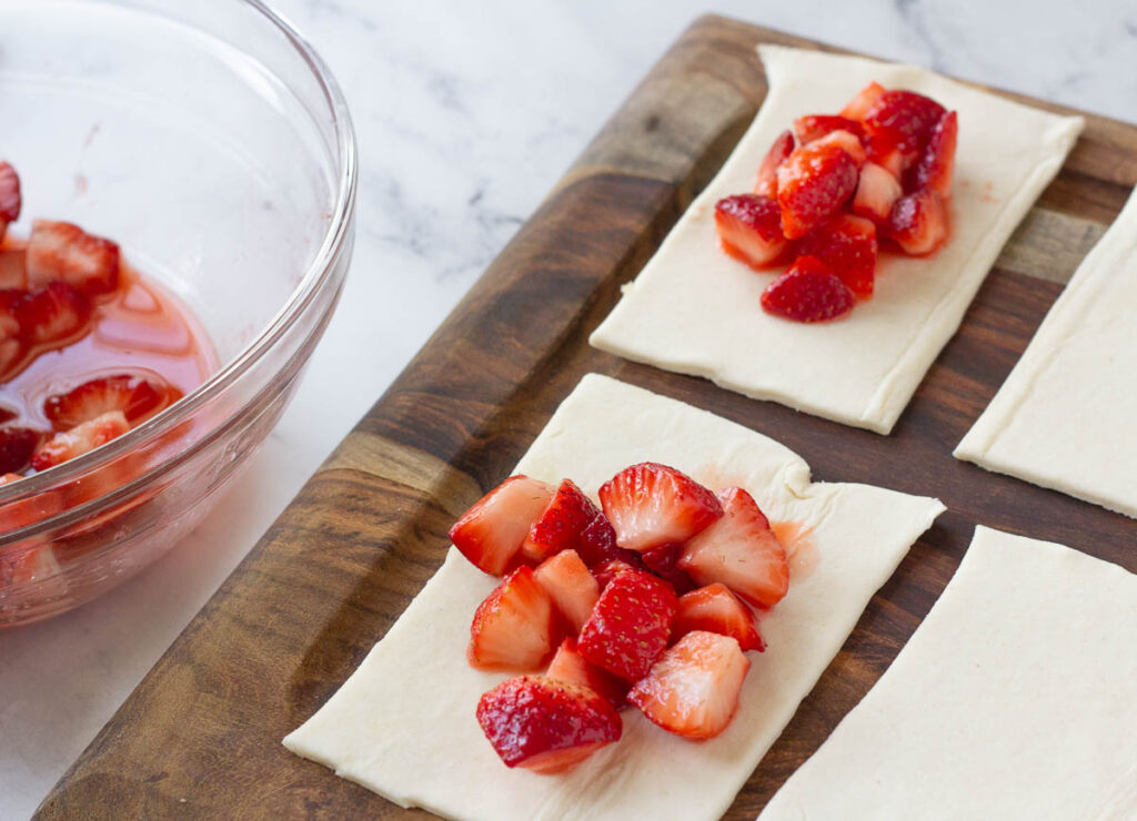 strawberry filling on puff pastry square