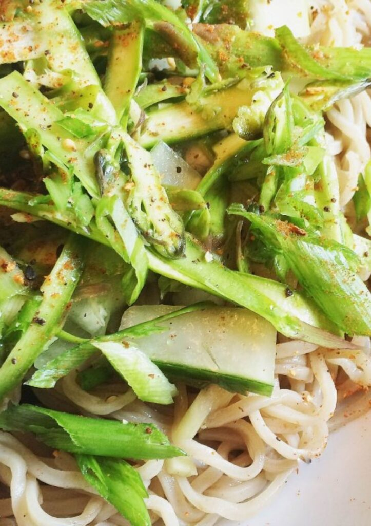 cold soba noodle salad with lots of fresh greens and scallions